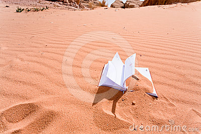 Note book in red sand dune of desert