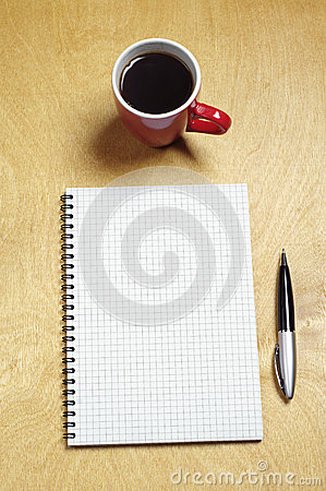 Note and cup of coffee
