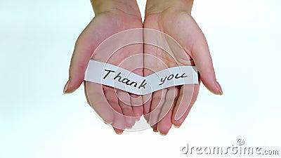 Note Merci aux mains des femmes sur fond blanc banque de vidéos