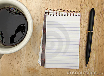 Note Pad Cup and Pen on Wood