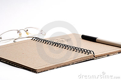Note pad pen and glasses