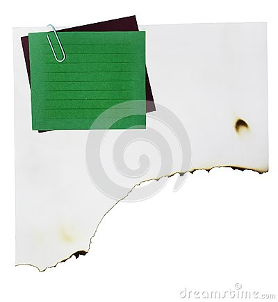 Note paper and paper clip on white paper burn