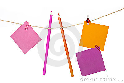 Note papers and colorful pencils on the rope