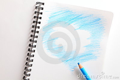 Notebook and blue pencil