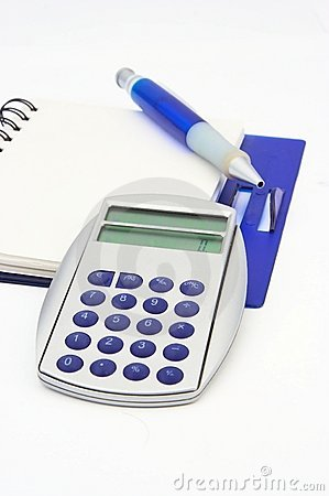 A notebook, a calculator and a pen isolated