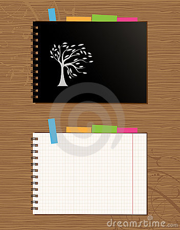 Notebook cover and page, wooden background