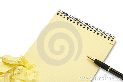 Notebook and crumpled paper wad with pen
