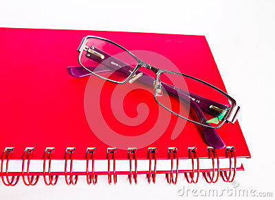 Notebook and eyeglasses.