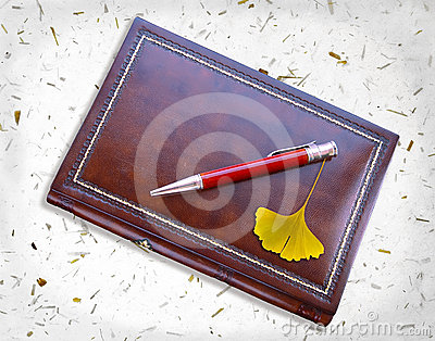 Notebook And Ginkgo Royalty Free Stock Images - Image: 24342769