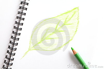 Notebook and green pencil with green leaf