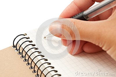 Notebook and hand with pen
