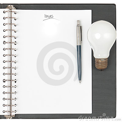 Notebook with pen and light bulb