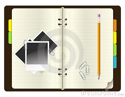 Notebook with pencil, paper clips and photos