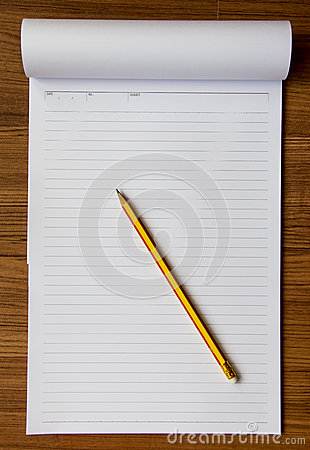 Notebook and pencil on wood background Stock Photo