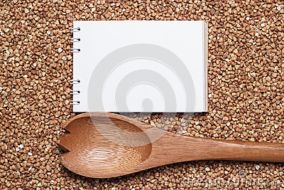 Notebook for recipe over buckwheat background