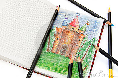Notebook with a sketch of a fairy castle & pencils