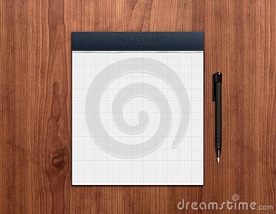 Notepad with pen on desk
