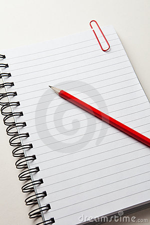 Notepad with a red pencil