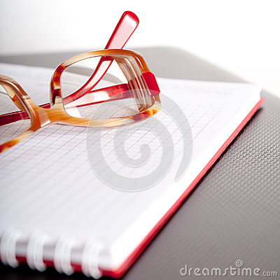 Notepad and spectacles