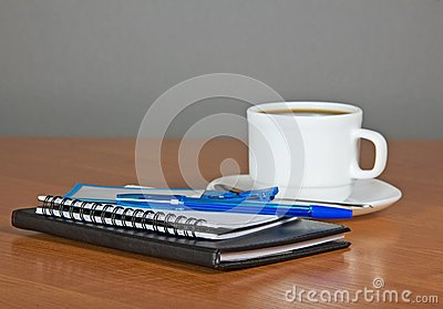 Notepads and coffee cup