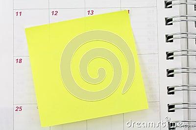 Notepaper sticking on calendar