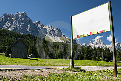 Notice on road with mountains