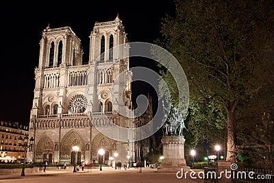 Notre Dame de Paris place illuminated in Paris.