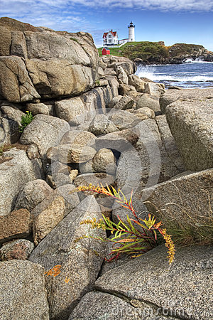 Free Nubble Light In Maine With Boulders In The Foreground Stock Image - 60600281
