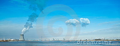 Nuclear power plant blue sky clouds harbor