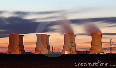 Nuclear power plant orange clouds at night