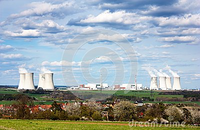 Nuclear power plant and spring time villag