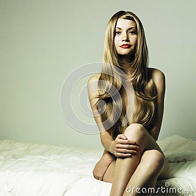 Nude elegant woman in bed