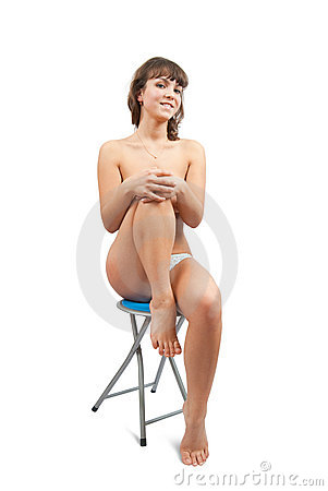 Nude girl  sitting on stool