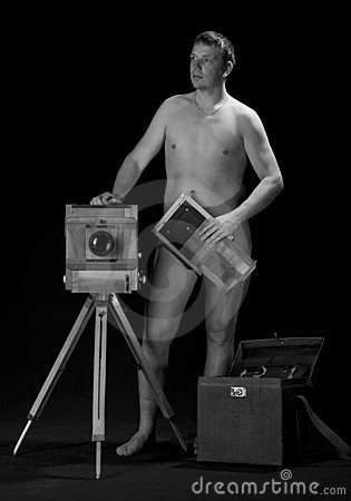 Nude man with photo equipment