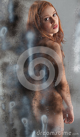 Nude Woman Behind Spray Painted Wall