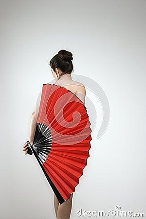 Nude woman with fan.