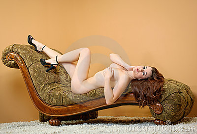 Nude woman laying on couch