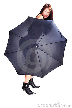 Nude woman with open umbrella.