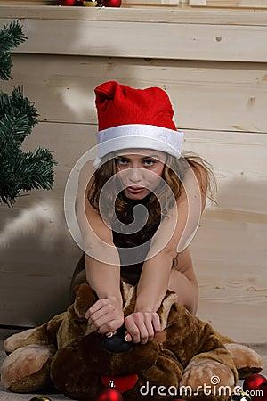 Nude woman in Santa hat