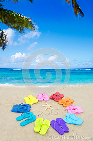 Number 2015 with color flip flops on the beach