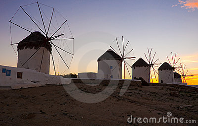 A number of famous windmills on Mykonos at sunset.