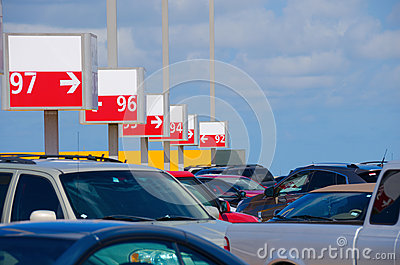 Numbered parking lot with many cars