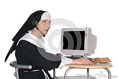 Nun on computer