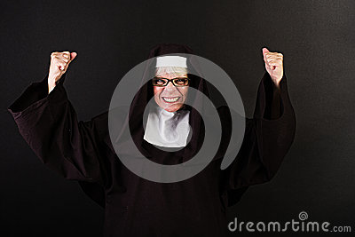 Nun with fists clenched