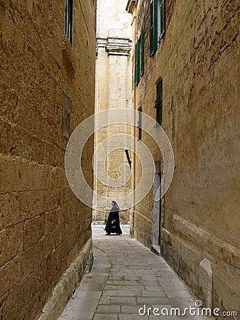 Nun and old walls.