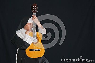 Nun playing the guitar
