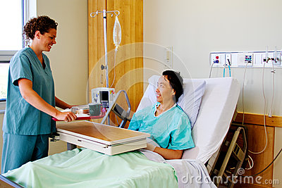 Nurse bringing meal tray to patient