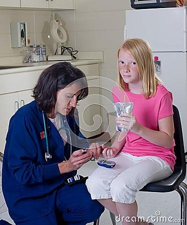 Nurse checking diabetic patient