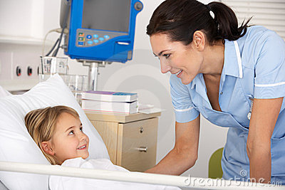 Nurse with child patient in UK A&E