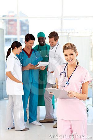 Nurse with colleagues in the background